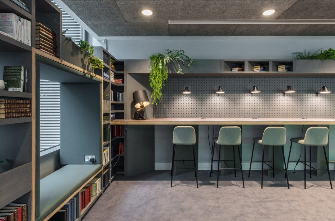 Library themed workplace seating area in The Living Rooms