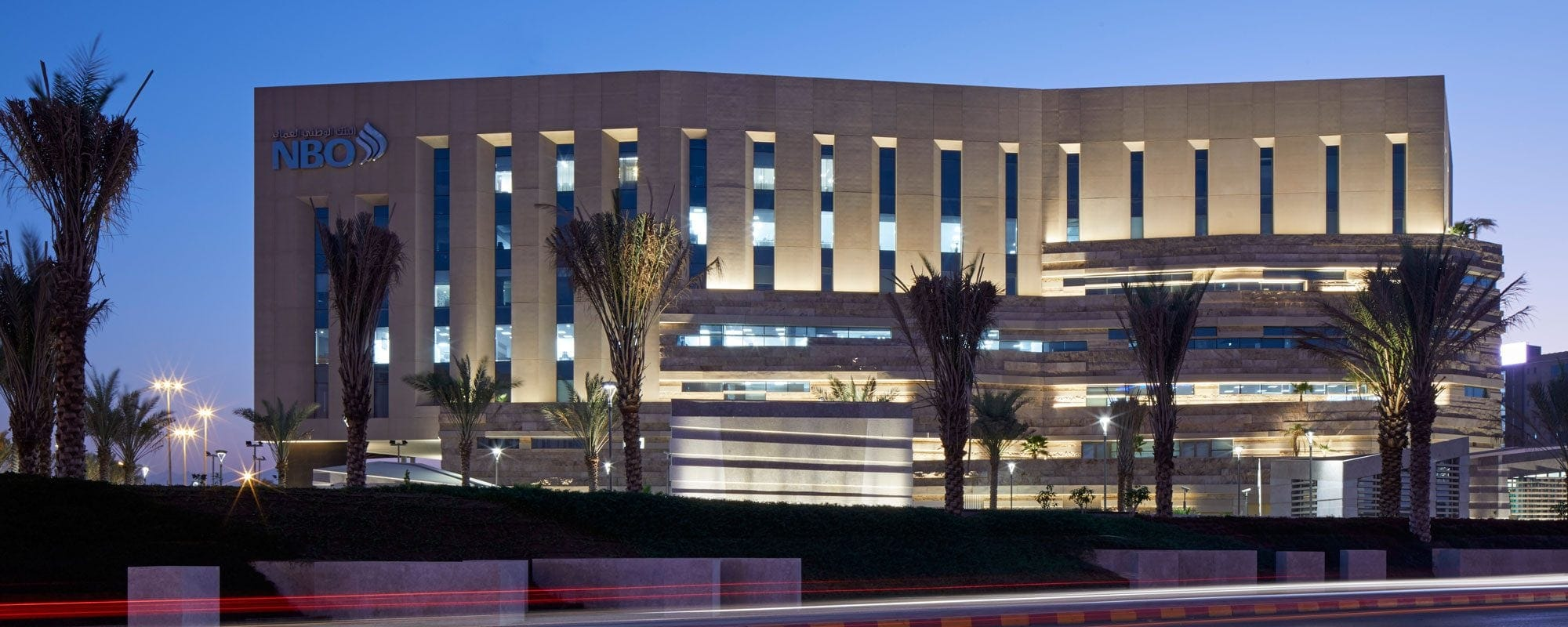 LOM architecture and design National Bank of Oman HQ facade night